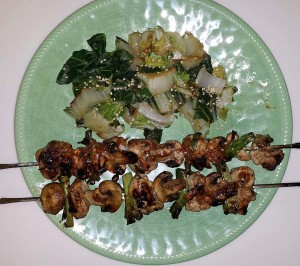 Chicken kabobs served with bok choy