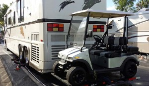 Golf cart mounted on rear of Newell coach