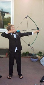 Connor practicing archery in his California James Bond outfit (check the footwear)