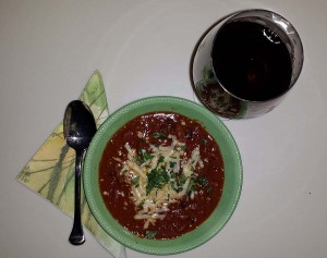 Beef and bean chili served with red wine