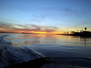 Sunset at the Mission Bay jetty from the stern of Bud's boat
