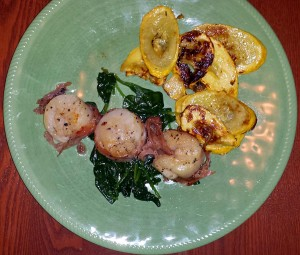 Grilled prosciutto wrapped scallops and summer squash