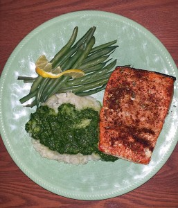 Cedar planked salmon with cauliflower-potato mash and cilantro-jalapeno pesto