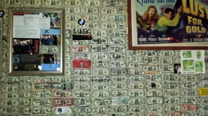 Dollar bills with names and places scrawled on them