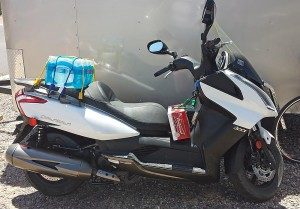 Scooter loaded under seat, on rear seat and in front
