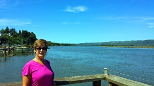 View down river toward Willapa Bay with Donna on the dock