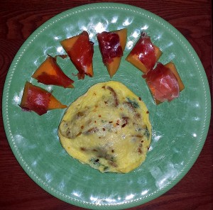 Omelette with prosciutto wrapped cantaloupe
