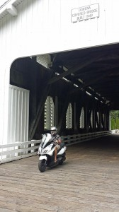 Scootering through the Dorena covered bridge