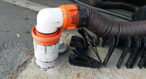 Sewer hose securely fastened to the drain pipe
