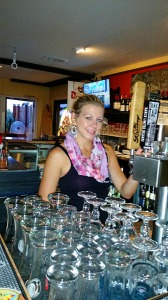 Courtney behind the bar at Dan Diego's