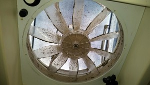 Dust clings to the galley fan blades