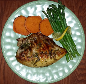 Brick grilled chicken with baked yams and asparagus