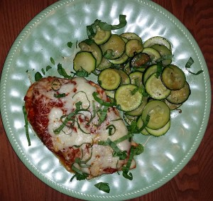 Pizza chicken with sauteed zucchini and onions