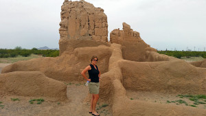 Donna in front of a smaller ruin in the compound
