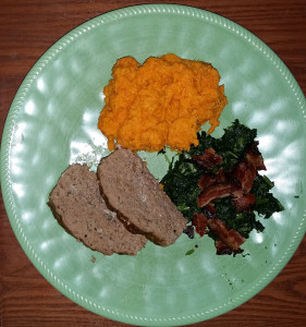 Meatloaf served with steamed Kale and bacon and mashed sweet potato