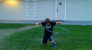 Dropping to his knees while hooping