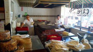 Making tortilla by the front window of the Old Town Mexican Cafe