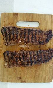 New York strips hot off the grill