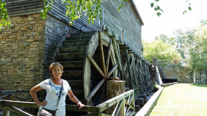 Donna by the water wheel that powers the mill