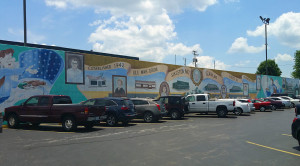 Mural by the parking lot depicting Lambert's history