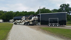 Millenium Coach with stacker heading out