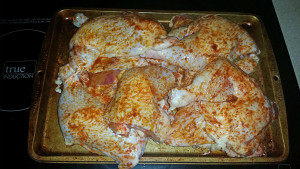 Chicken leg quarters seasoned and ready to grill