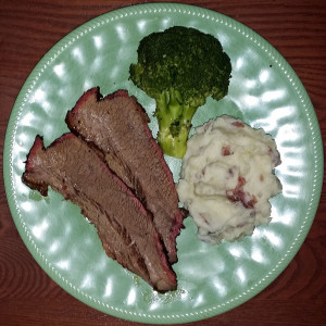 Tender, moist smoked brisket with garlic smashed potatoes and brocolli