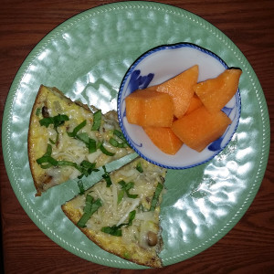 Frittata for breakfast with fresh cantaloupe