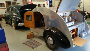 Teardrop trailer pulled by a 1948 Ford