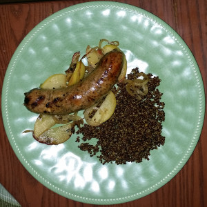 Sausage over sauteed onions and apple slices with Morroccan quinoa on the side