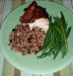 Dinner plate with a wild rice blend with dried cranbeeries, pecans and scallions.