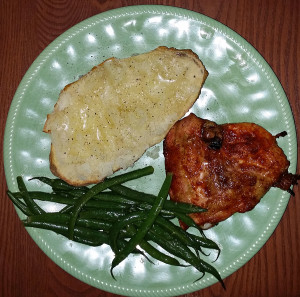 Dry rubbed chicken thighs, baked potato and lemony green beans