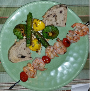 Shrimp skewer with baby squash assortment and kalamata olive bread