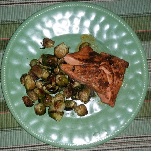 Sweet and spicy salmon served with roasted brussel sprouts
