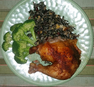Roasted chicken quarter with broccoli and wild rice cranberry salad