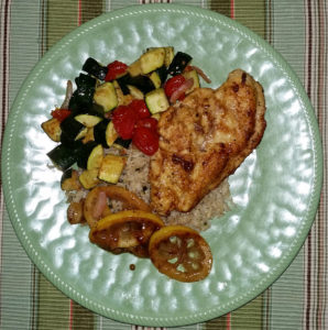 Lemon-butter chicken breasts with roasted zucchini and tomatoes