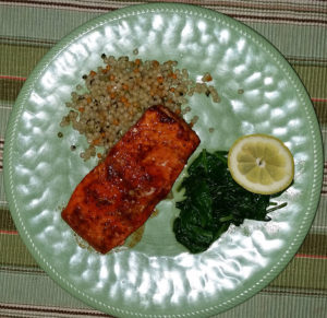 Sweet and spicy salmon with spinach and Israeli cous-cous