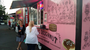 Donna and Kathy at the VooDoo Donuts cart.