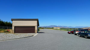 Paved parking and storage buildings