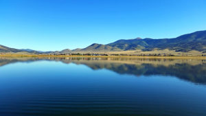 Glassy water with reflections of the mountains