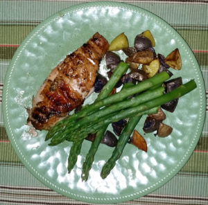 Traeger chicken with roasted potatoes and asparagus