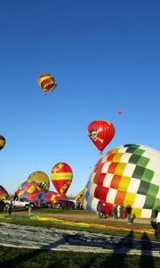Balloons inflating and launching