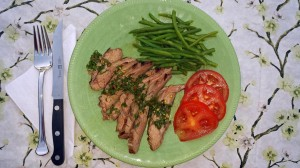 Grilled garlic-rubbed flank steak with chimichurri sauce