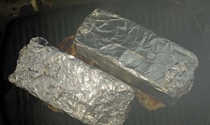 Foil wrapped bricks on chicken breasts