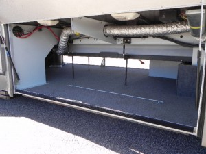 Large pass-through basement compartment