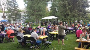 People enjoying the food and music outdoors
