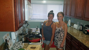 Cat and Shauna slaving over the stove