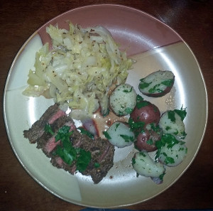 Corned beef style flank steak with braised cabbage and potatoes