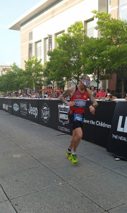 Allen checking his watch 100 yards from the finish