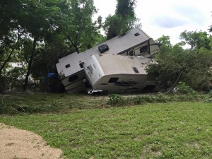 RVs tossed aside by flood water